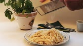 Spaghetti - freshly cooked and delicious, on the pasta is sprinkled with a rubbed grated hard cheese.