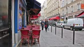 resim yazı : PARIS, FRANCE - March 22, 2016: The streets and cozy cafes of Paris. France. Stok Video