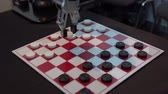 chess board : Robot playing checkers. Hand manipulator moves checkers. Stock Footage