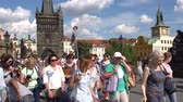 terracota : Prague, Czech Republic - JULY 2017: Architecture and traffic in Prague , Czech Republic. Tourists walking along the Charles Bridge in Prague.