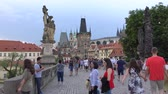 терракота : Prague, Czech Republic - JULY 2017: Architecture and traffic in Prague , Czech Republic. Tourists walking along the Charles Bridge in Prague.