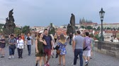 gotický : Prague, Czech Republic - JULY 2017: Architecture and traffic in Prague , Czech Republic. Tourists walking along the Charles Bridge in Prague.