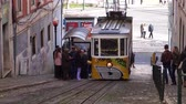 elevador : LISBON, circa 2017: Old tram elevator Gloria in the old town of Lisbon Portugal. Lisbon is the capital of Portugal, is continental Europes capital city and the only one along the Atlantic coast. Stock Footage