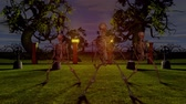 dia das bruxas : Dancing skeletons in the cemetery at night. Halloween concept.