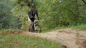 time : A cyclist rides on a small hill Stock Footage