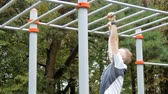 close up : A man is doing chin-ups Stock Footage