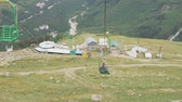 boarding pass : Chair lift in an empty ski resort in the summer. Tourists visiting the valley and glaciers