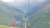 elbrus : Chair lift in an empty ski resort in the summer. Tourists visiting the valley and glaciers
