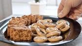 cake chocolate : Cookies in a plate put on the table. Close-up. Good snack for tea. Stock Footage