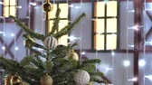 orb : Christmas toys hanging on the tree. The city is decorated for the holiday. Colored garland Stock Footage