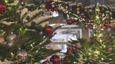 christmas tree ornament : Street cafe is beautiful for Christmas. Festive atmosphere in the street. The city is decorated for the holiday. Colored garland Stock Footage
