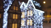 csecsebecse : Fabulous Christmas decorations on the streets of the city, Out of focus, they are decorated with luminescent garlands.