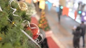 gratidão : Festive atmosphere in the mall. In the foreground a new year ball. Not in focus people walk and buy gifts.