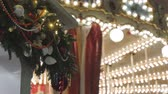 Festive atmosphere. People ride on the carousel. In the evening, during a snowfall. Stock Footage