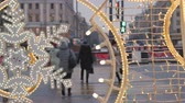 Christmas decorations on the streets. Against the background is not the focus of the movement of cars and crowds of people. Stock Footage