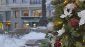 Christmas toys hanging on the tree. In the background, the movement of cars is out of focus. Stock Footage