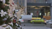 bombki : Christmas toys hanging on the tree. In the background, the movement of cars is out of focus. Festive atmosphere.