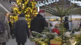 Christmas decorations on the streets of the big city. Out of focus people go shopping.