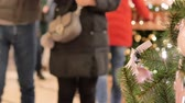gratitude : Festive atmosphere in the mall. In the foreground Christmas fir. Not in focus people walk and buy gifts.