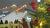 Festive atmosphere. In the background, children ride from the ice slide. Not in focus. Holiday in the New Years weekend