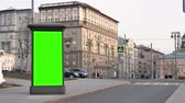 day City street Showcase with green screen stands against backdrop of buildings Stock Footage