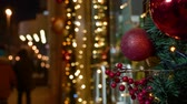 porte dorée : Winter evening Street of city Xtmas decoration hanging Garland lights sparkle Vidéos Libres De Droits