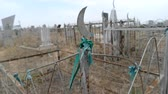 pedra tumular : Green ribbon on the fence of old historic tombstone in the muslim cemetery Astrakhan Russia