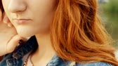 искажение : Grainy old film shot of ginger haired woman weared blue leans jacket closeup