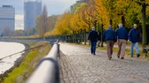 gyalogló : Bonn, Germany: 21 of october 2017: Group Of People Walking on embankment of Rhine River