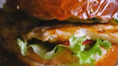 table styling : Beautiful Tasty Chicken Burger Turns In Slow Motion.