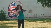 elation : Young girl turning with Union Jack in her hands in slow motion