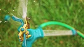 hrubý : Sprinkler system working top view in slow motion