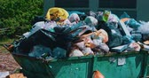 leftover : Astrakhan, Russia 06 Sep. 2018: Overfilled trash dumpster in the street in Astrakhan. Stock Footage