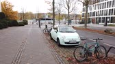 yeraltı : Bonn Germany, 06 November 2019: POV of riding bicycle lane toward UN campus station Regular train arriving 4k 50fps clip footage