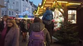 kerstbal : Bonn Germany, 30 November 2019: Overcrouded street in the center of Bonn City. People walking in the street on Christmas market event HD hyperlapse clip