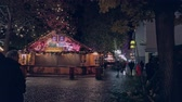 kerstbal : Bonn, Germany - 14 of Dec., 2019: Christmas market in the nighttime.Christmas market stopped working in the dead of night panning shot