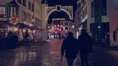 deutschland : Bonn, Germany - 14 of Dec., 2019: Christmas market in the nighttime. People walk along the decorated street for Christmas 4k 60 fps slowmotion.