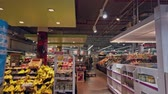 középkorú : Bonn, Germany - 14 of Dec., 2019: interior shot of REWE supermarket in Bonn POV view Stock mozgókép
