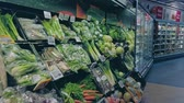 középkorú : Bonn, Germany - 14 of Dec., 2019: interior shot of REWE supermarket in Bonn POV view. Healthy eating vegetables on the shelves of the Rewe mall