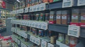 középkorú : Bonn, Germany - 14 of Dec., 2019: interior shot of REWE supermarket in Bonn POV view. Shelves with seasonings. Lots of different spices worth for sale 4k
