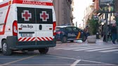 レスポンス : Valencia,Spain - March 18, 2019:  Ambulance van. Red cross ambulance  and national police car. Responding  to emergency. 動画素材