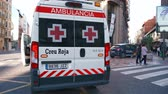 レスポンス : Valencia, Spain, March 20, 2019: Paramedic getting into ambulance van. Red cross ambulance  and national police car. Responding  to emergency.
