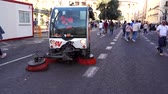 lavagem : Street cleaning machine. Sweeping the street. Dirty pavement cleaning vehicle. Valencia city center.