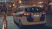 municipal services : A Spanish  Valencian local Police Car patrolling Valencia city during night.  Night patrol. Stock Footage