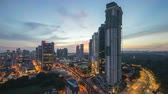 district : Day to night time lapse of Kuala Lumpur downtown scene. Tilt down Stock Footage