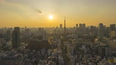 4k time lapse of day to night sunset scene at Tokyo city skyline with Tokyo Tower. Tilt up 動画素材
