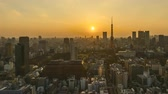 4k time lapse of day to night sunset scene at Tokyo city skyline with Tokyo Tower. Pan left