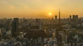 4k time lapse of day to night sunset scene at Tokyo city skyline with Tokyo Tower. Pan right 動画素材