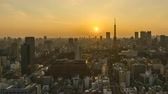 4k time lapse of day to night sunset scene at Tokyo city skyline with Tokyo Tower. Zoom in 動画素材