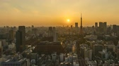 4k time lapse of day to night sunset scene at Tokyo city skyline with Tokyo Tower. Zoom out